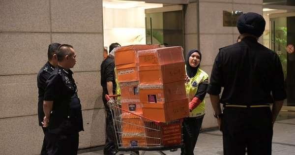 Hundreds of designer handbags, jewelry, cash seized from former